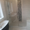 Walk In Shower Area With Vertical Mosaic Strip