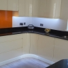 Luxury Handle Less Fitted Kitchen With Solid Worktops