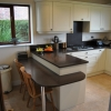Luxury Kitchen Installation Including MINERVA Solid Worktops & Breakfast Bar Seating Area