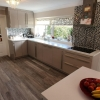Schuller-Sand-Grey-Gloss-Units-With-MAIA-Cristallo-Solid-Worktops